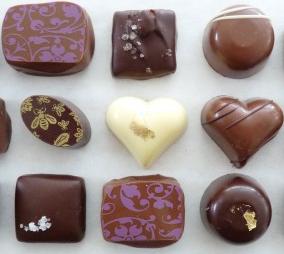 "Visit <a href=""https://www.blackdinahchocolatiers.com/"" target=""_blank"">Black Dinah Chocolatiers</a>"
